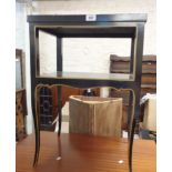 A 48cm ebonised and gilt lined two tier occasional table, set on slender cabriole legs
