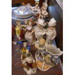 Seven assorted Continental ceramic figurines