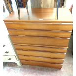 An 82cm retro Avalon teak effect two part chest of seven graduated drawers, set on plinth base