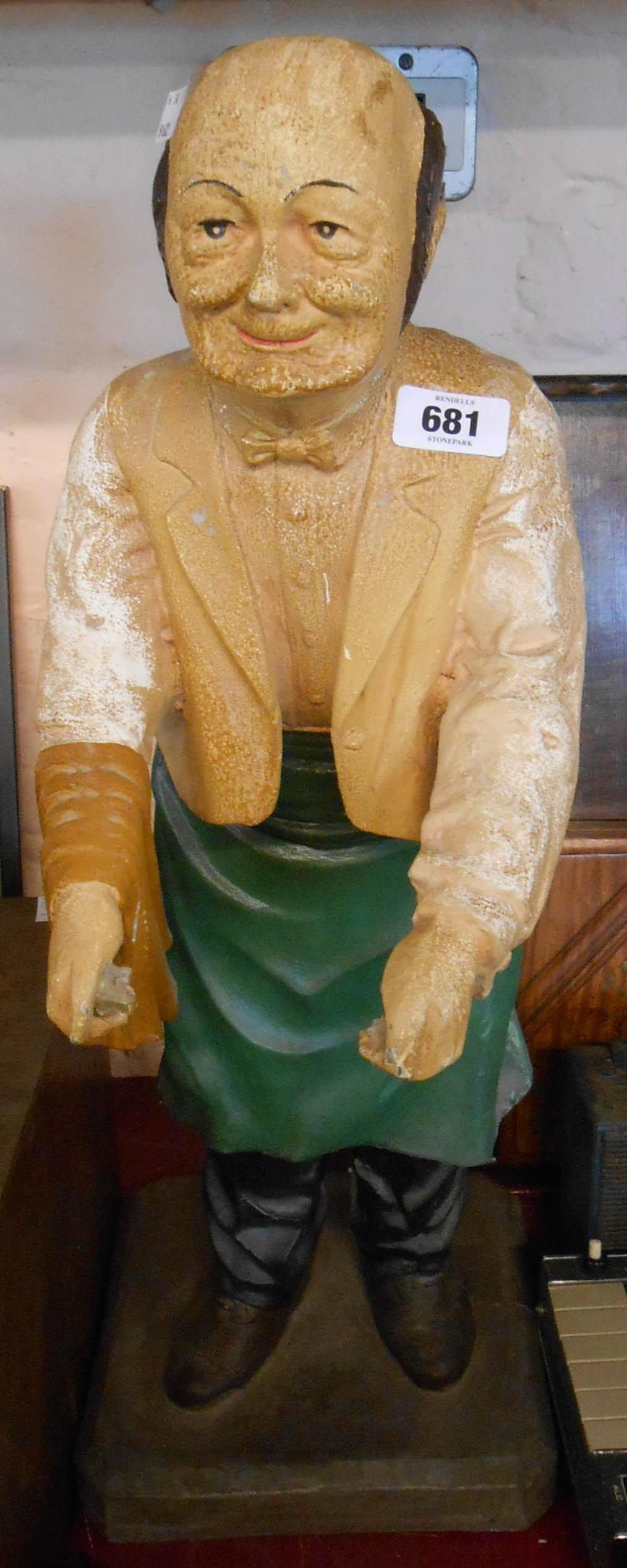 A vintage fibreglass dumb waiter display figure - tray missing