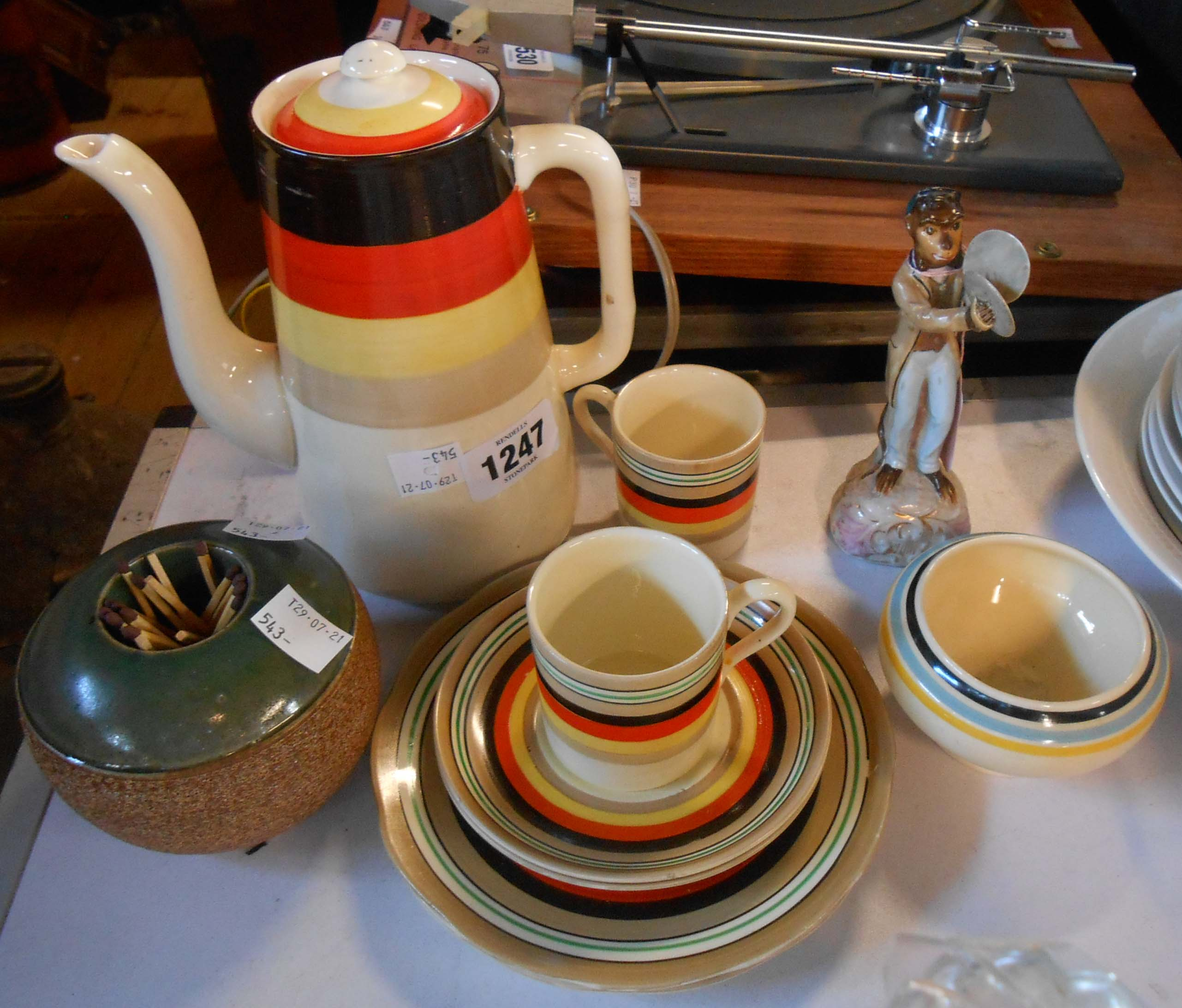 An Art Deco Bisto rainbow ware coffee pot and two trios with colourful banded decoration - sold with