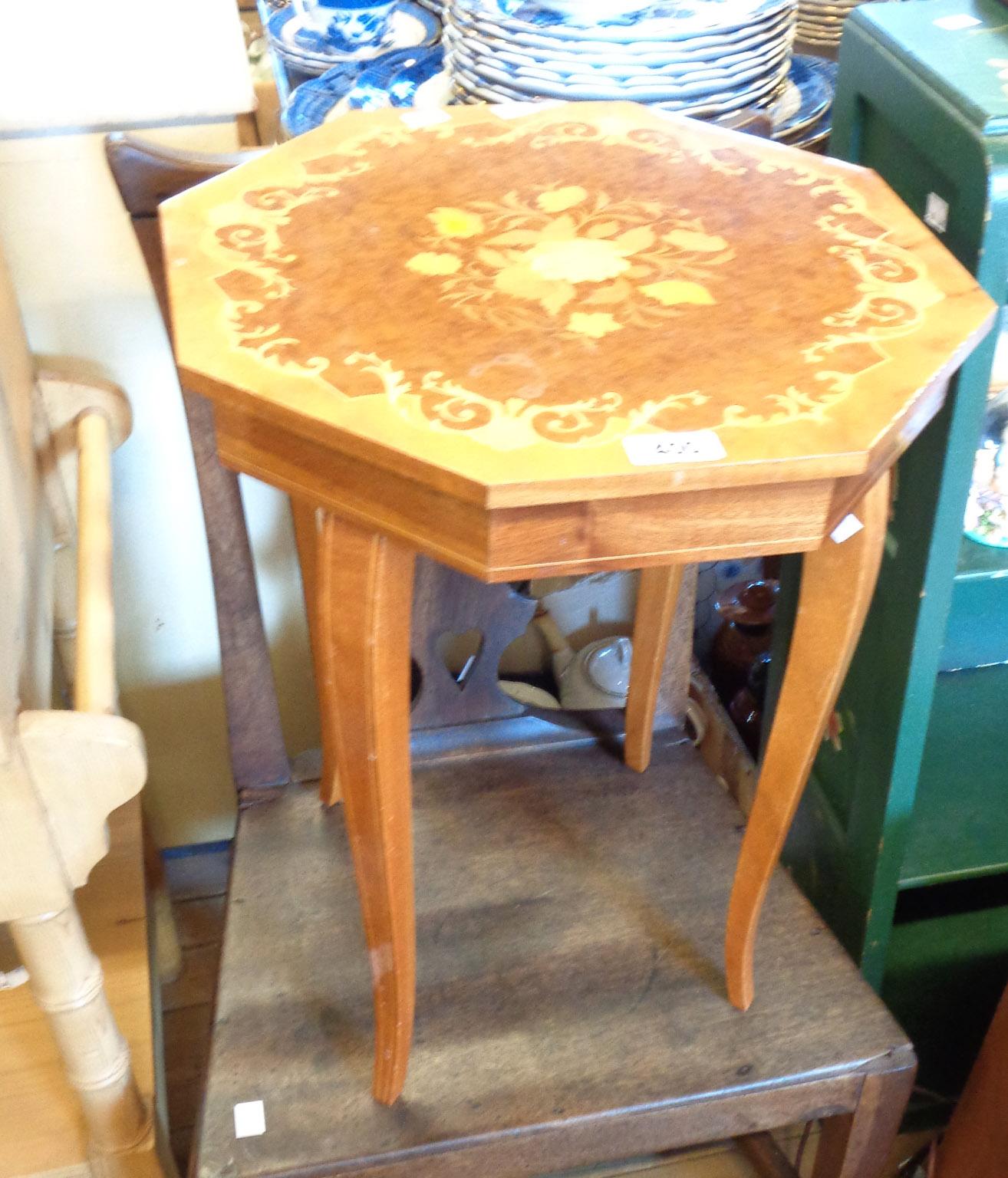 A souvenir Sorrento ware musical table