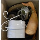 A box containing assorted items including lamp, letter wrap, wooden figures, etc.