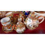 A Japanese eggshell porcelain part tea set comprising teapot, hot water jug, sucrier, four cups