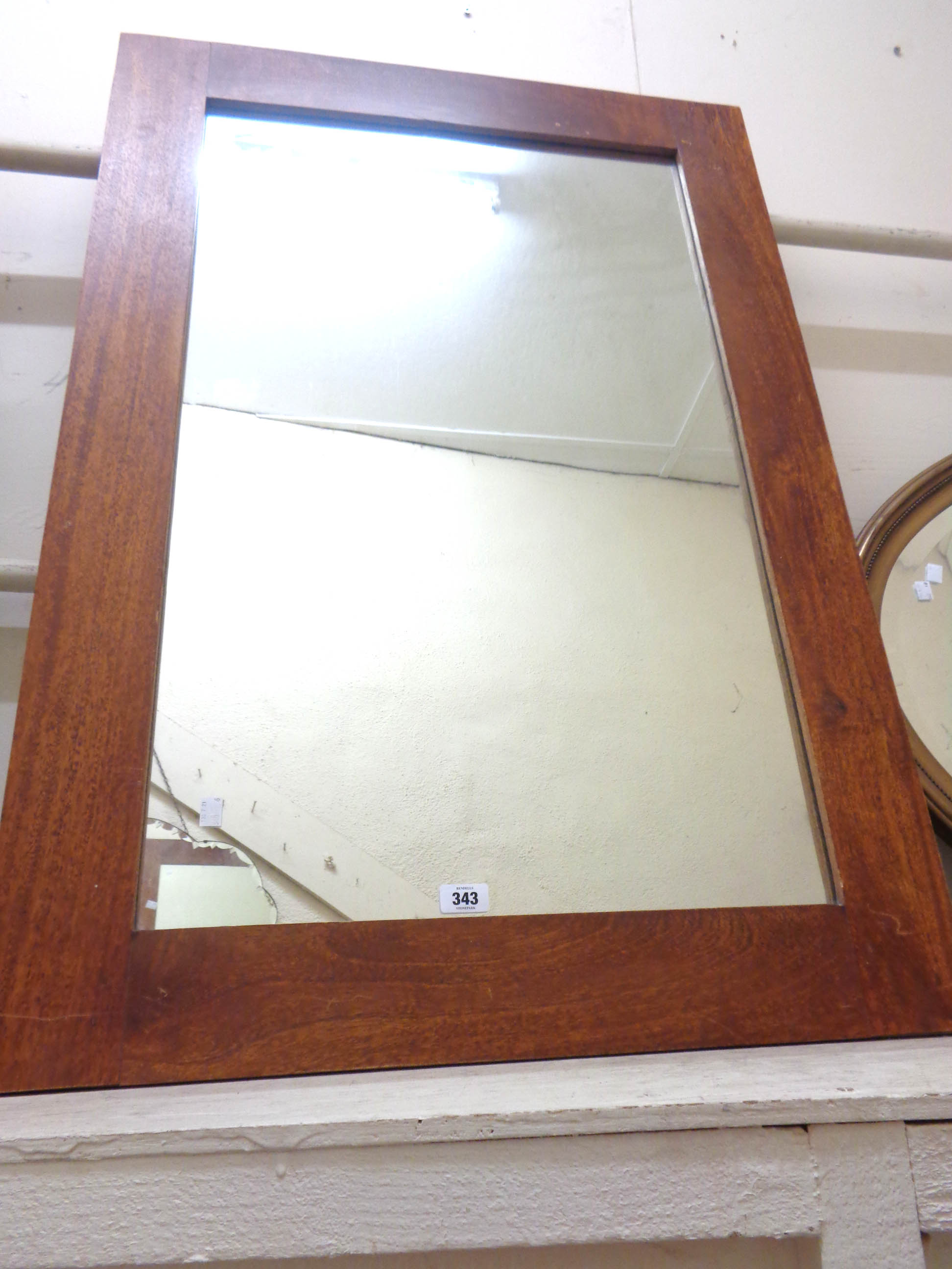 A 1.1m X 76cm modern hardwood framed oblong wall mirror