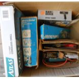 A box containing assorted tools included Atlas cordless drill, Black & Decker finishing saw, etc.