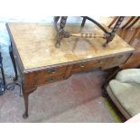 A 1.25m antique figured walnut and cross banded kneehole desk with central frieze drawer and four