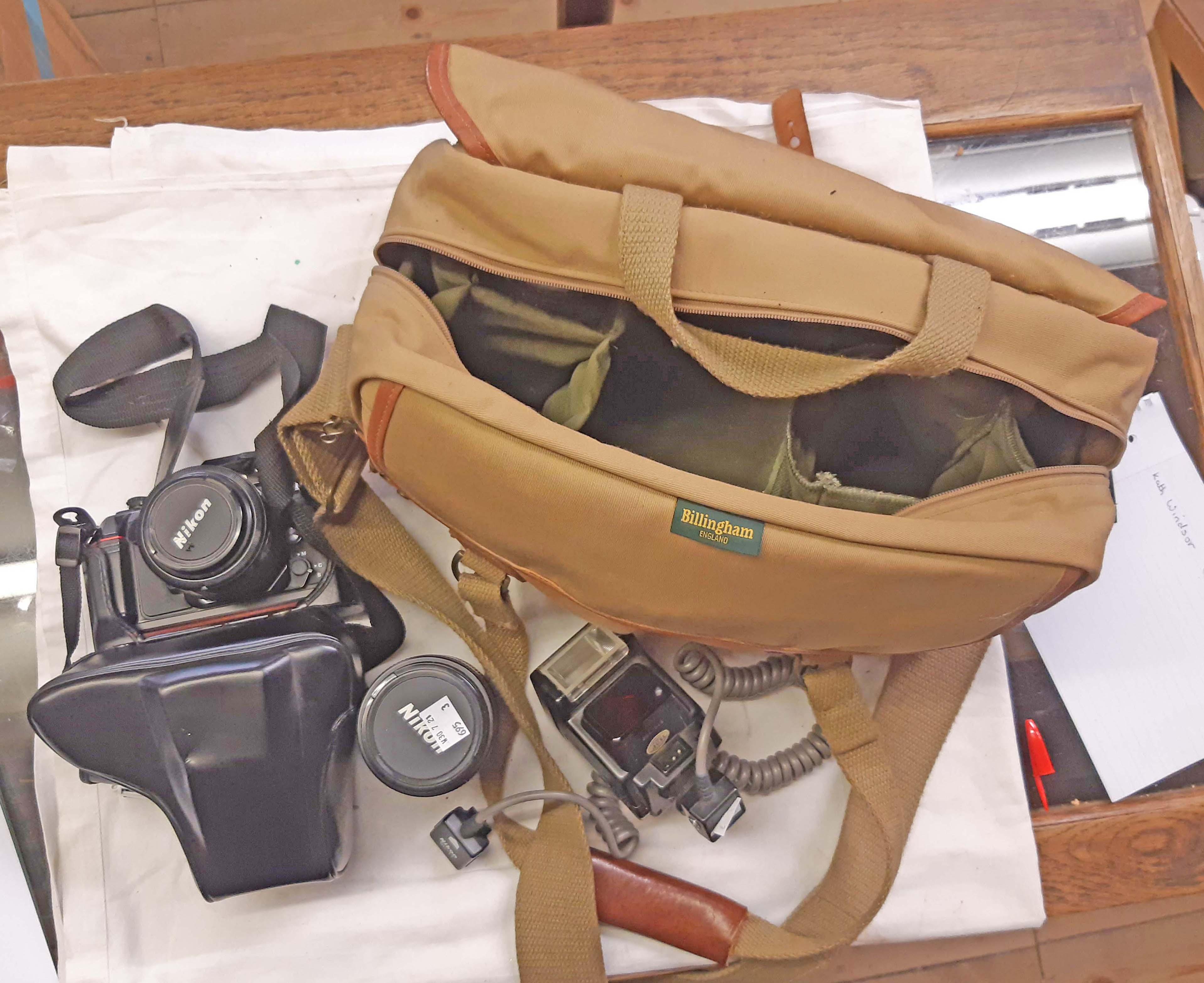 A Nikon F-501 AF 35mm camera outfit with Nikkor lens, Nikkor 70-210mm lens, flash unit, etc. - in