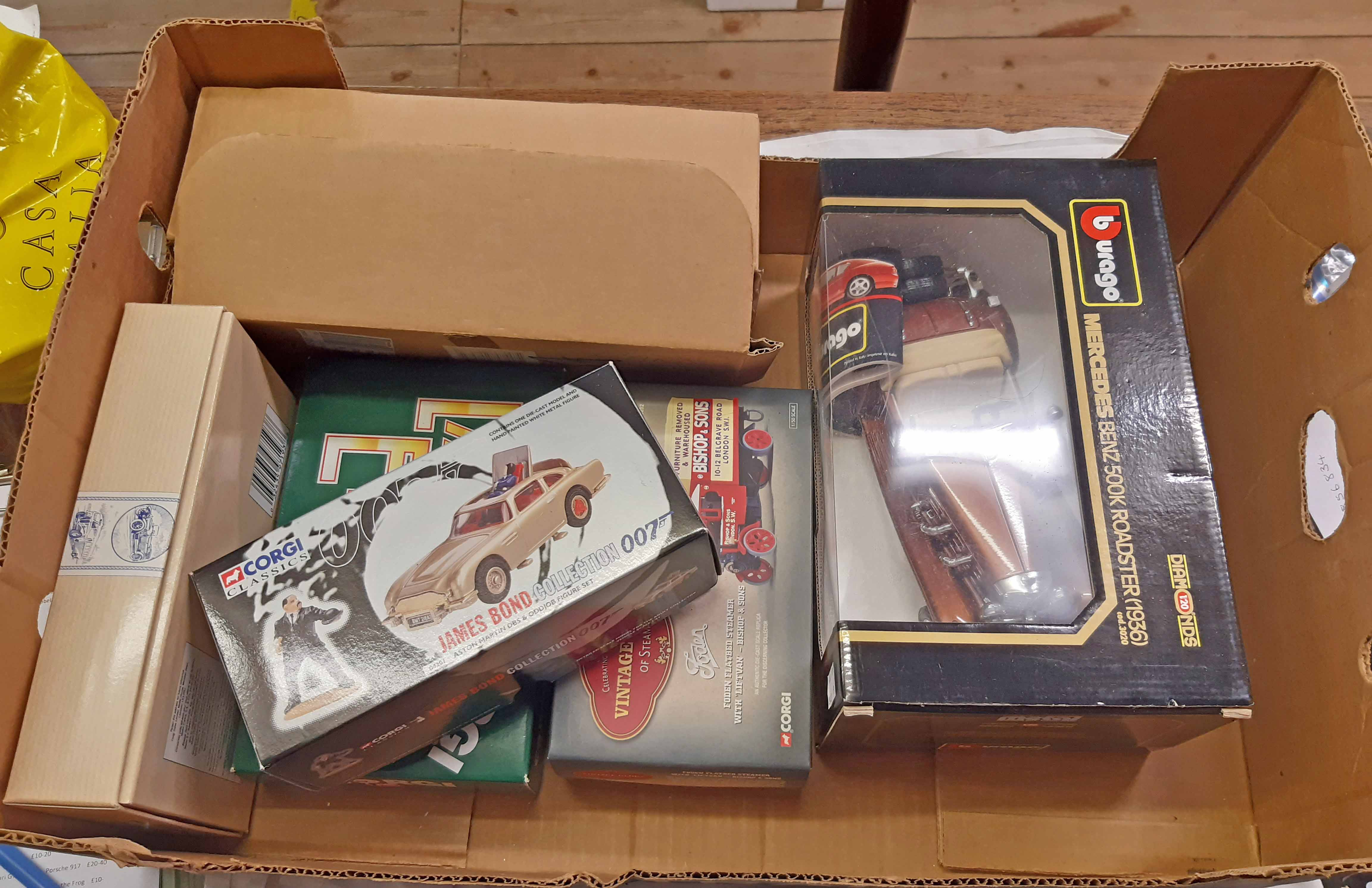 A box containing mixed die cast toy vehicles (most boxed) including Corgi James Bond Goldfinger