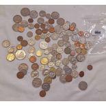 A bag containing assorted world coinage including Australia, New Zealand, Netherlands, USA,
