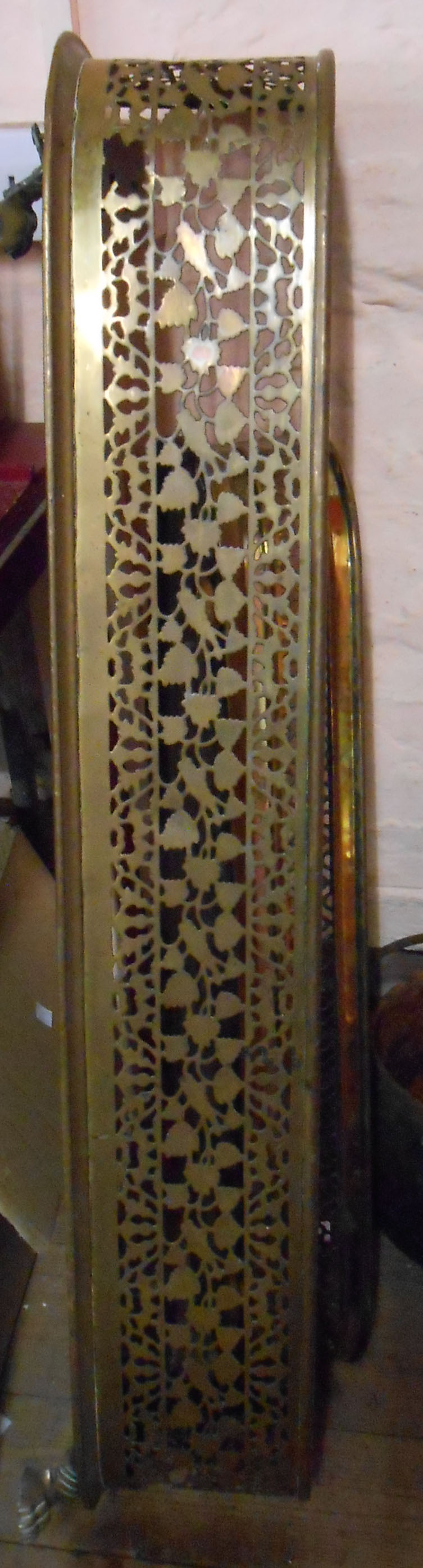 A late 19th Century brass fire kerb fender with pierced frieze decoration - sold with a smaller