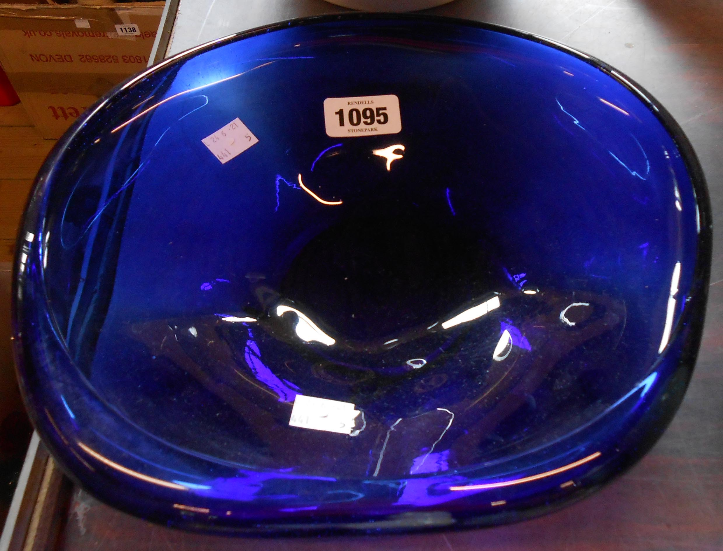 A large free form blue glass dish
