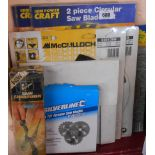 A selection of mainly unopened circular saw and brush cutter blade sets