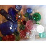 A crate containing assorted glassware including blue chemist and others bottles, glass free form