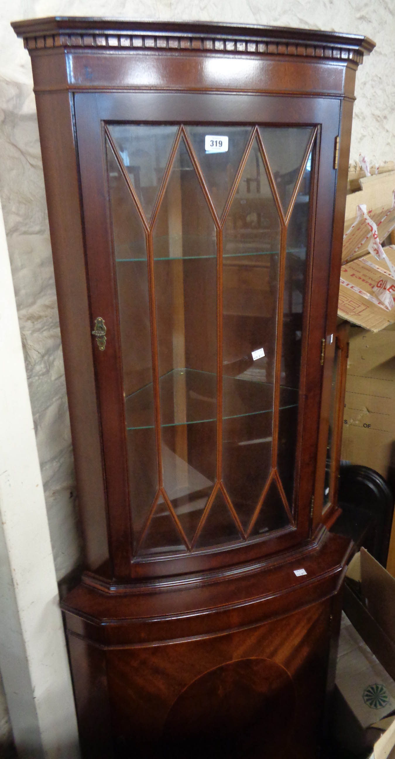 A 66cm reproduction mahogany corner cabinet with glazed top and cupboard under, set on bracket feet