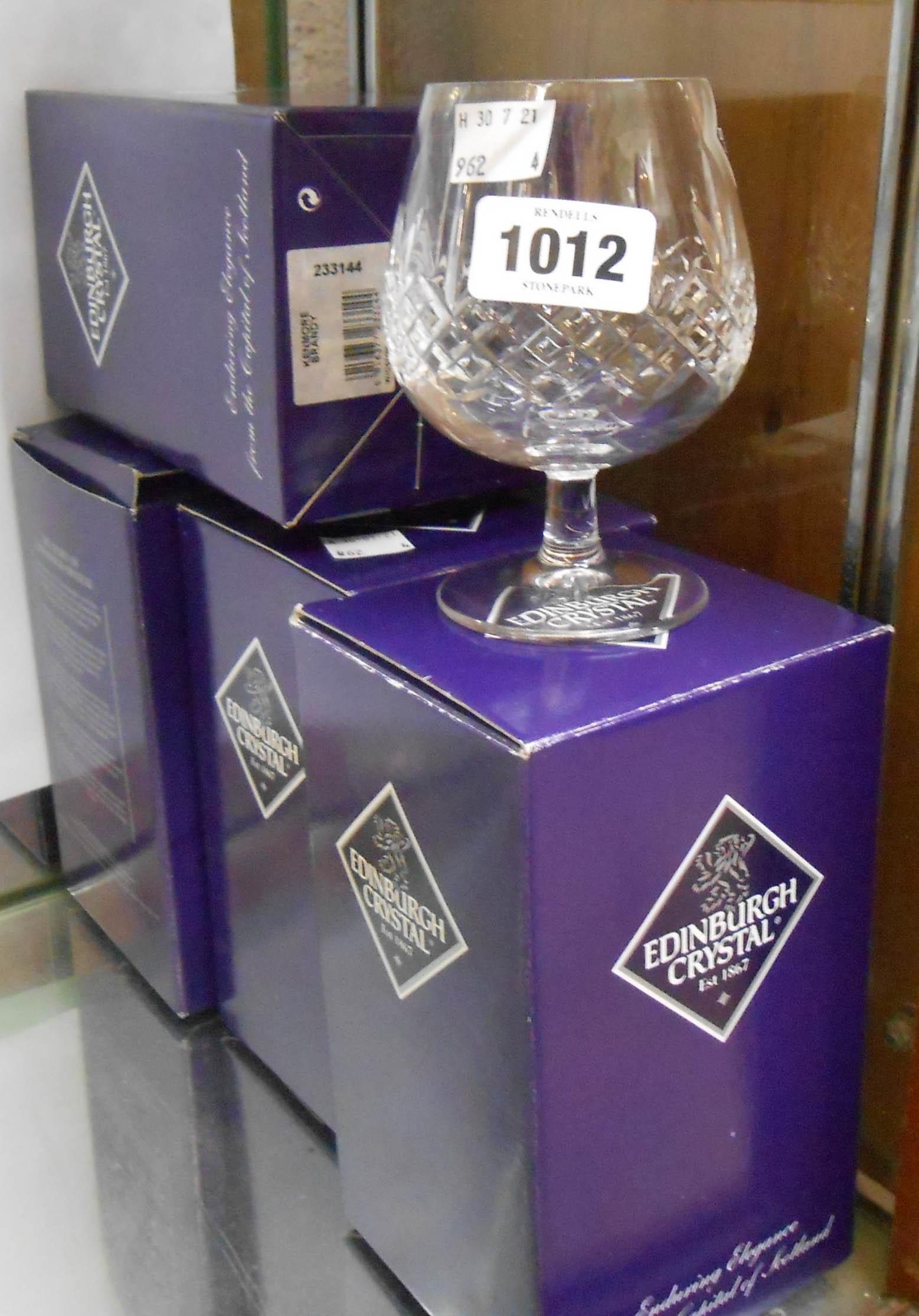 Four boxed Edinburgh crystal brandy balloons
