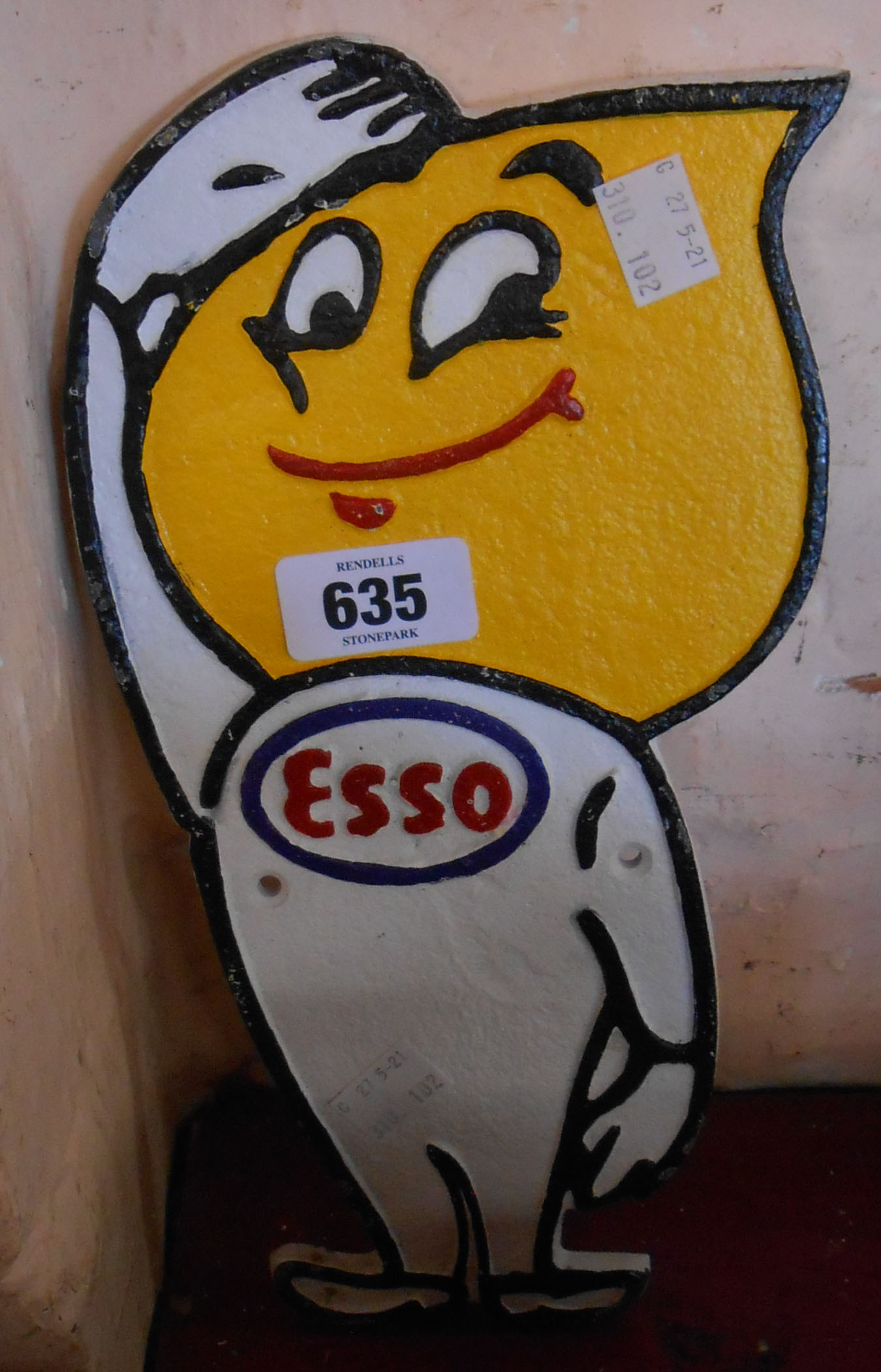 A modern reproduction painted cast iron cut out Esso Man sign