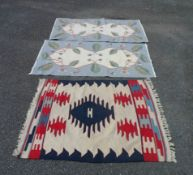 A 20th Century Pakistan kelim with repeat geometric designs on a cream ground - sold with two