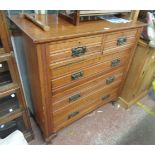 A 103cm Edwardian walnut chest of two short and three long drawers, set on short cabriole legs