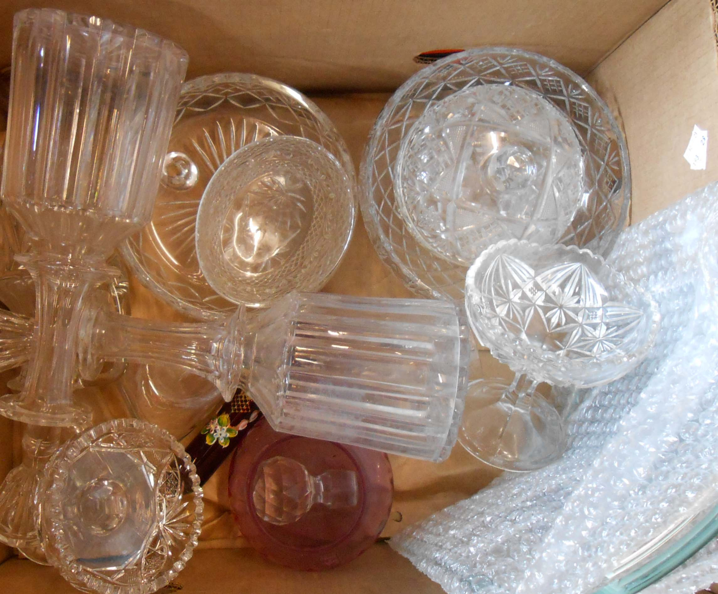 A box containing a quantity of glassware including pair of decanters, fruit bowls, picture frame,