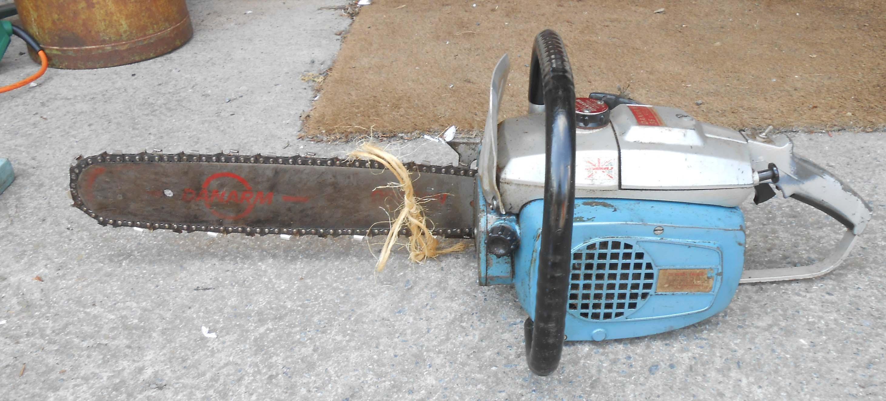 A Danarm Mk11 55 automatic petrol chainsaw