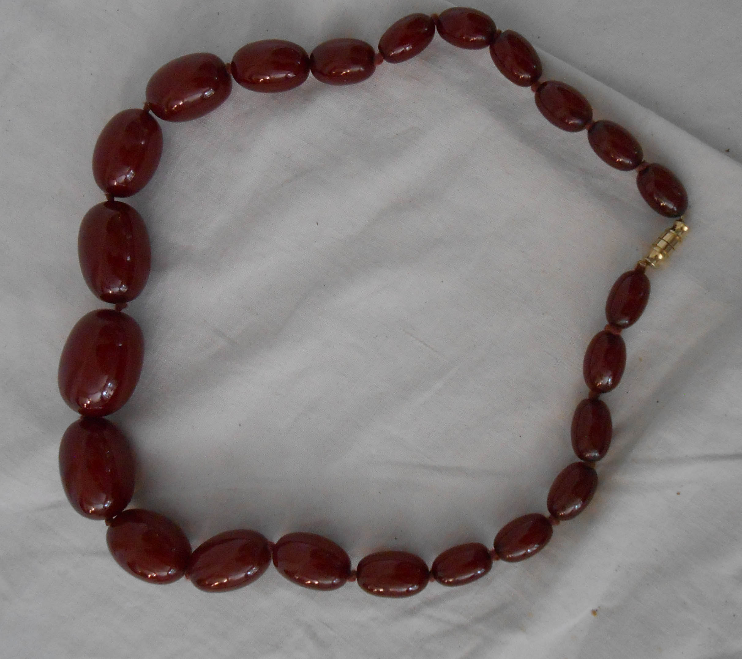 A red amber graduated bead necklace