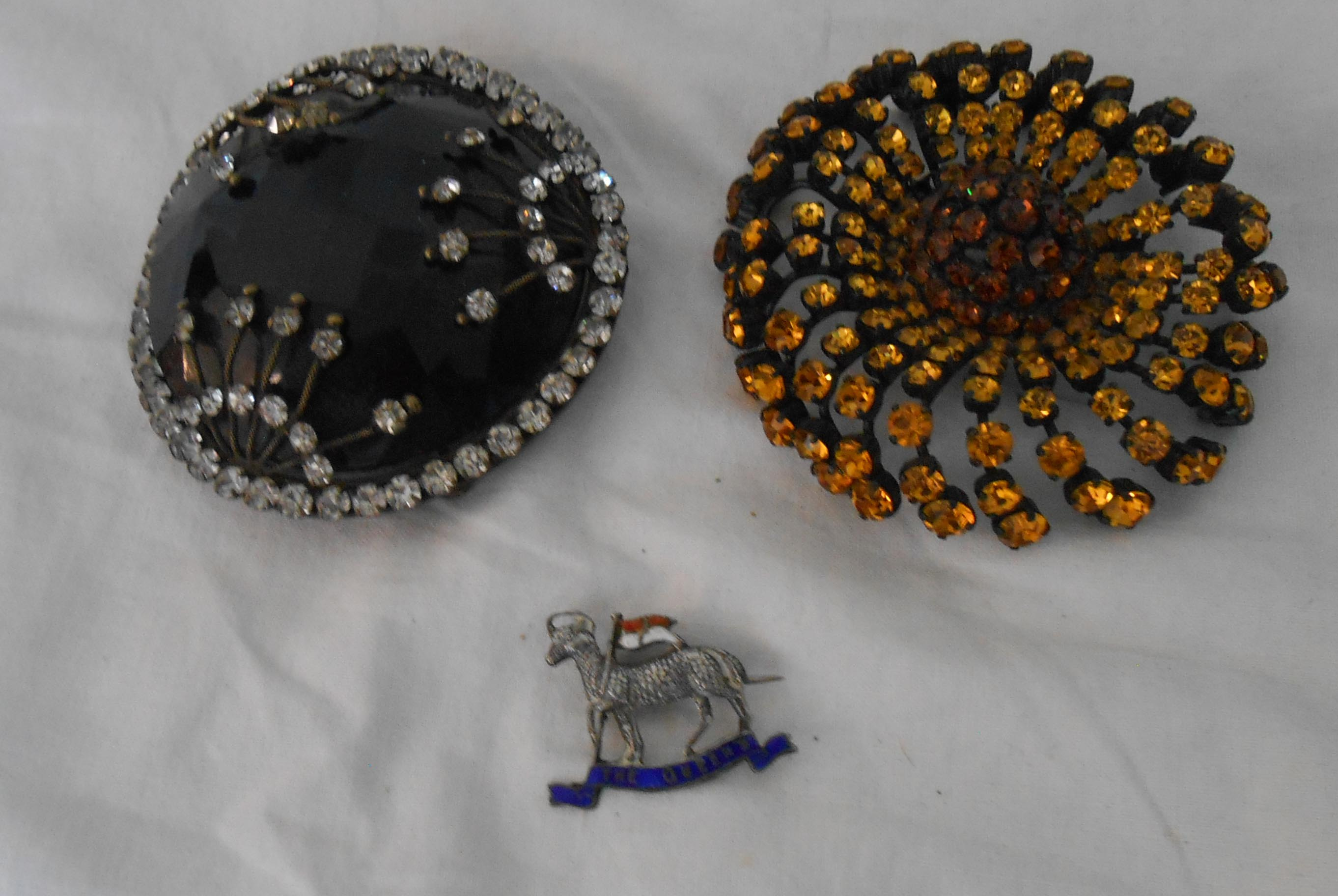 Two large vintage brooches and a Queen's Regiment lamb pattern military brooch