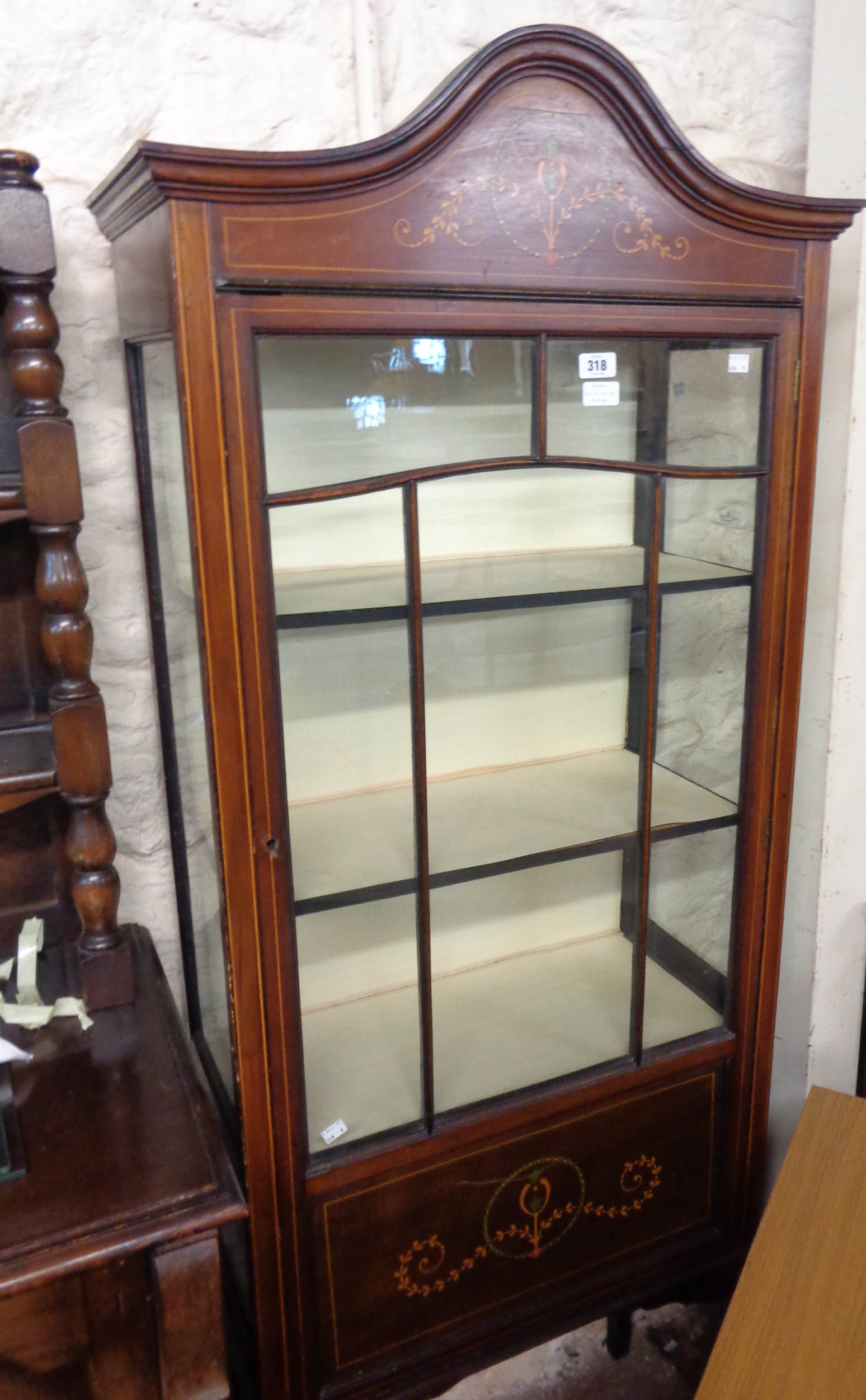 A 64cm Edwardian walnut and strung display cabinet with material lined interior enclosed by a glazed