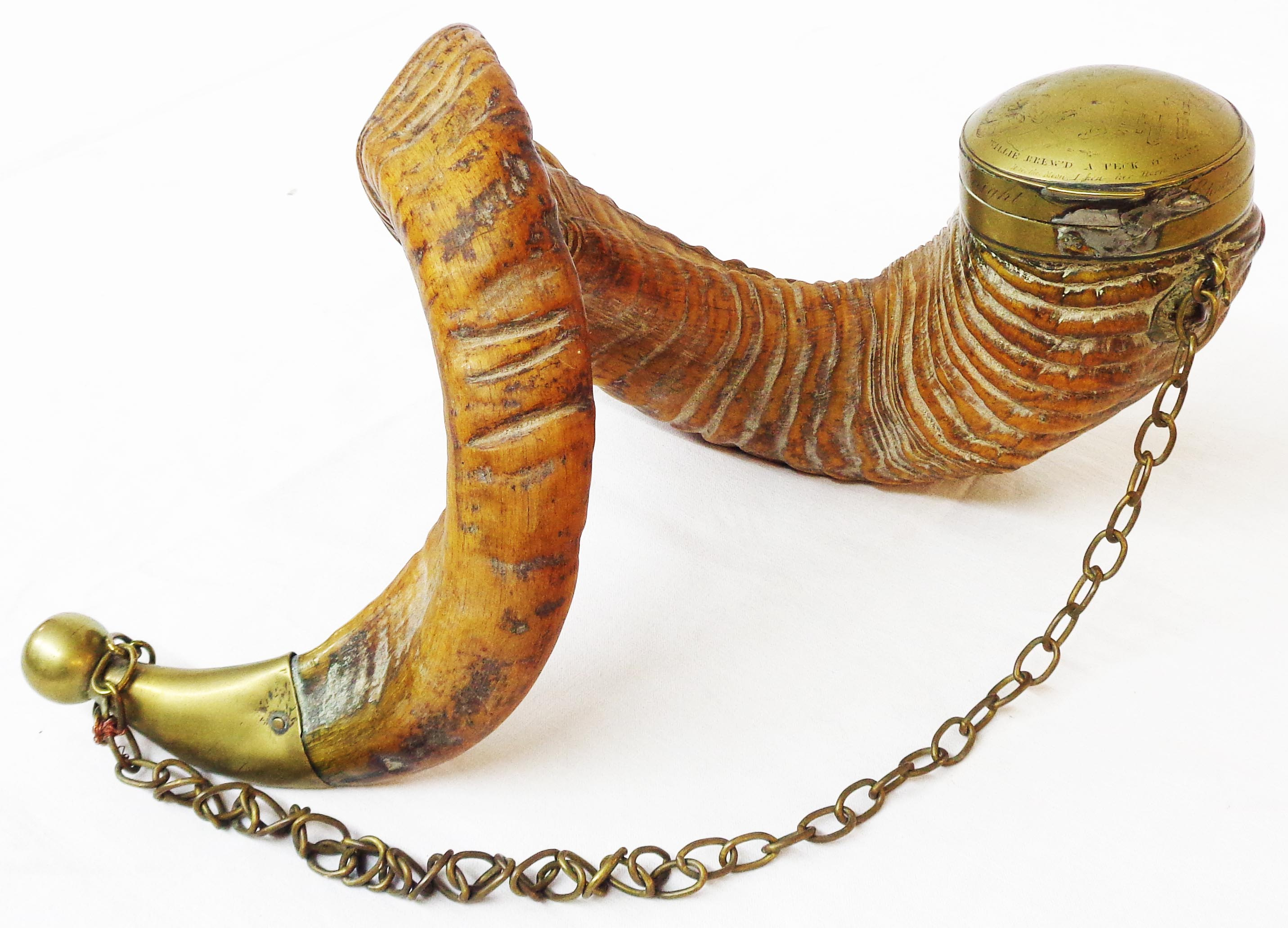 An early 19th Century Scottish snuff mull formed from a large ram's horn with brass mounts and