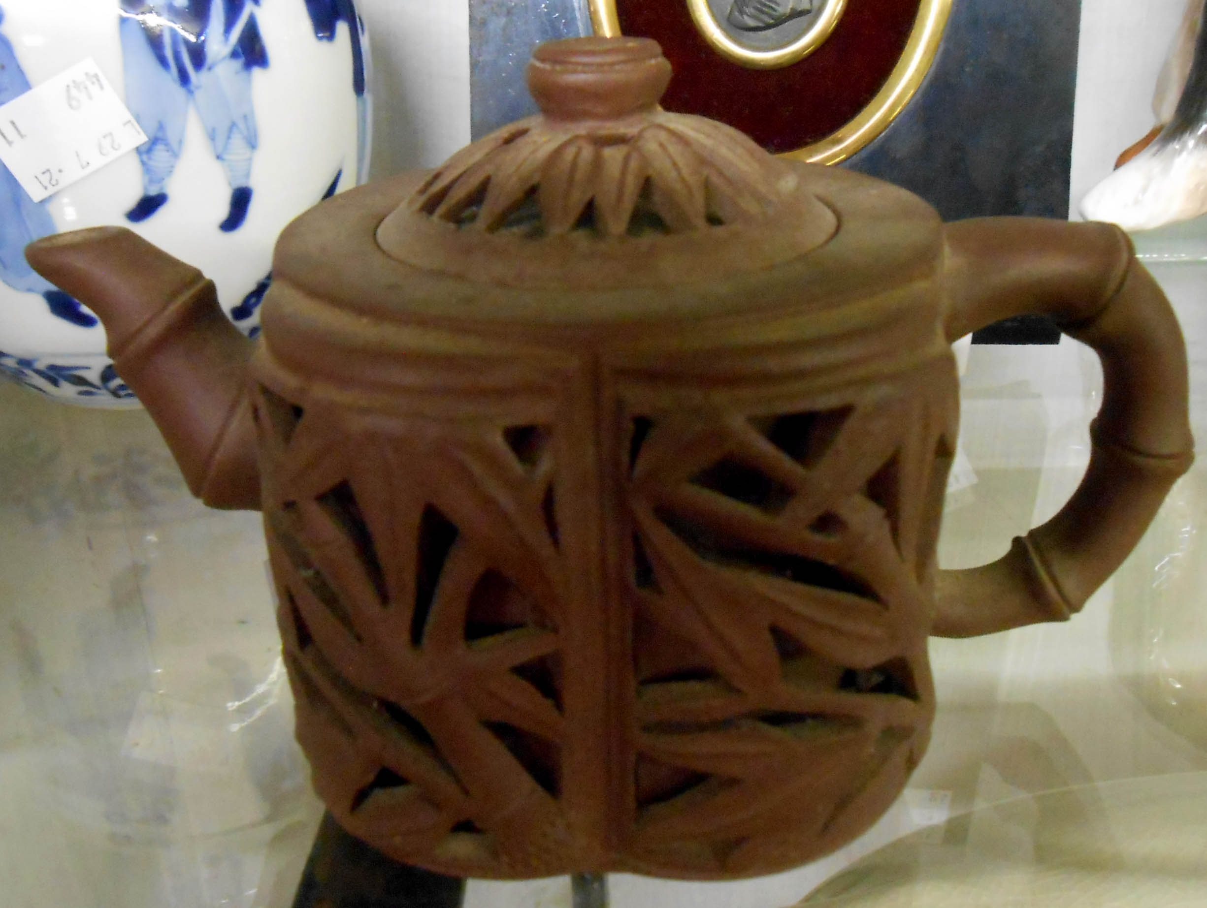 A Chinese Yixing zisha clay teapot decorated with reticulated bamboo form panels - bearing seal
