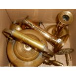A box containing a pair of 19th Century candlesticks, brass kettle, etc.