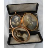 Three yellow metal framed photographic portraits and a leather clad folding case