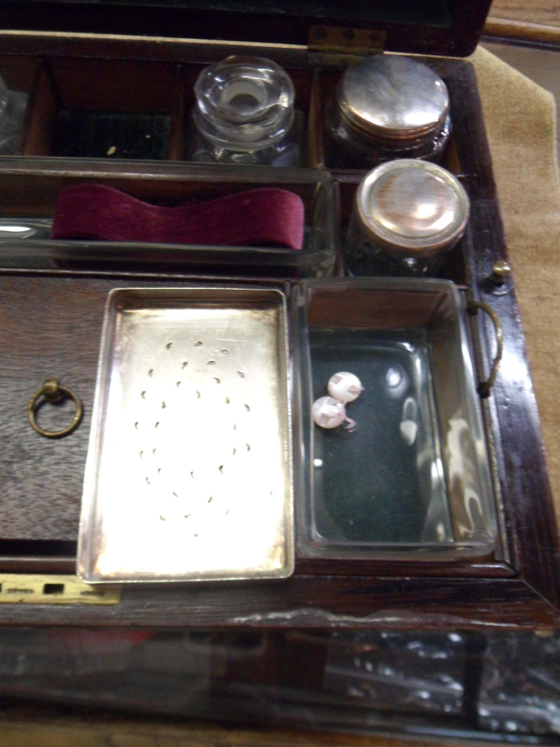 A Victorian rosewood veneered travelling vanity box, the interior fitted with glass jars and boxes - Image 4 of 5