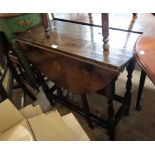 An 82cm late 18th Century oak gateleg table with drawer to one end, set on turned supports