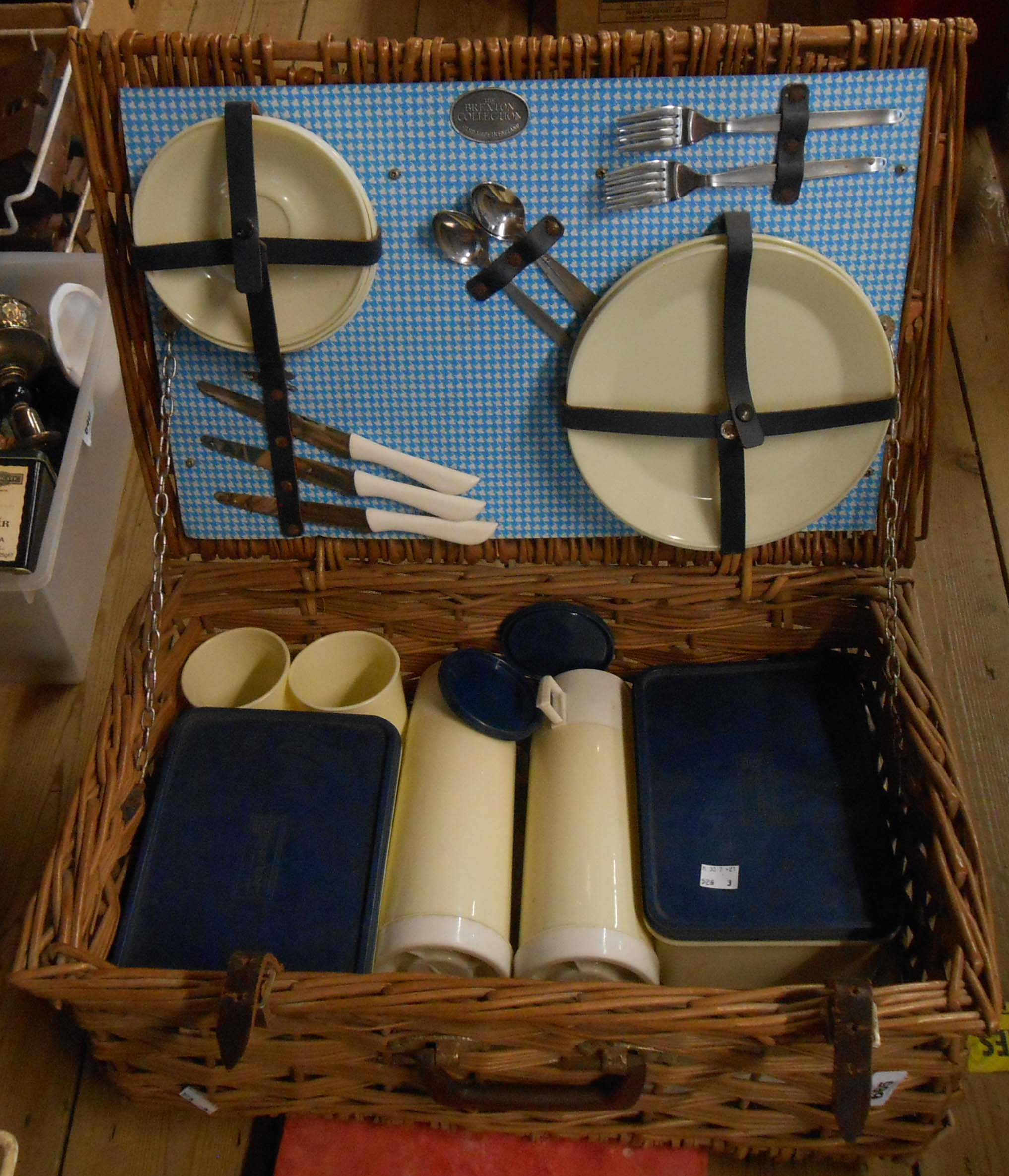 A Brexton picnic set in wicker hamper with sandwich boxes, thermos flasks, plates, etc.