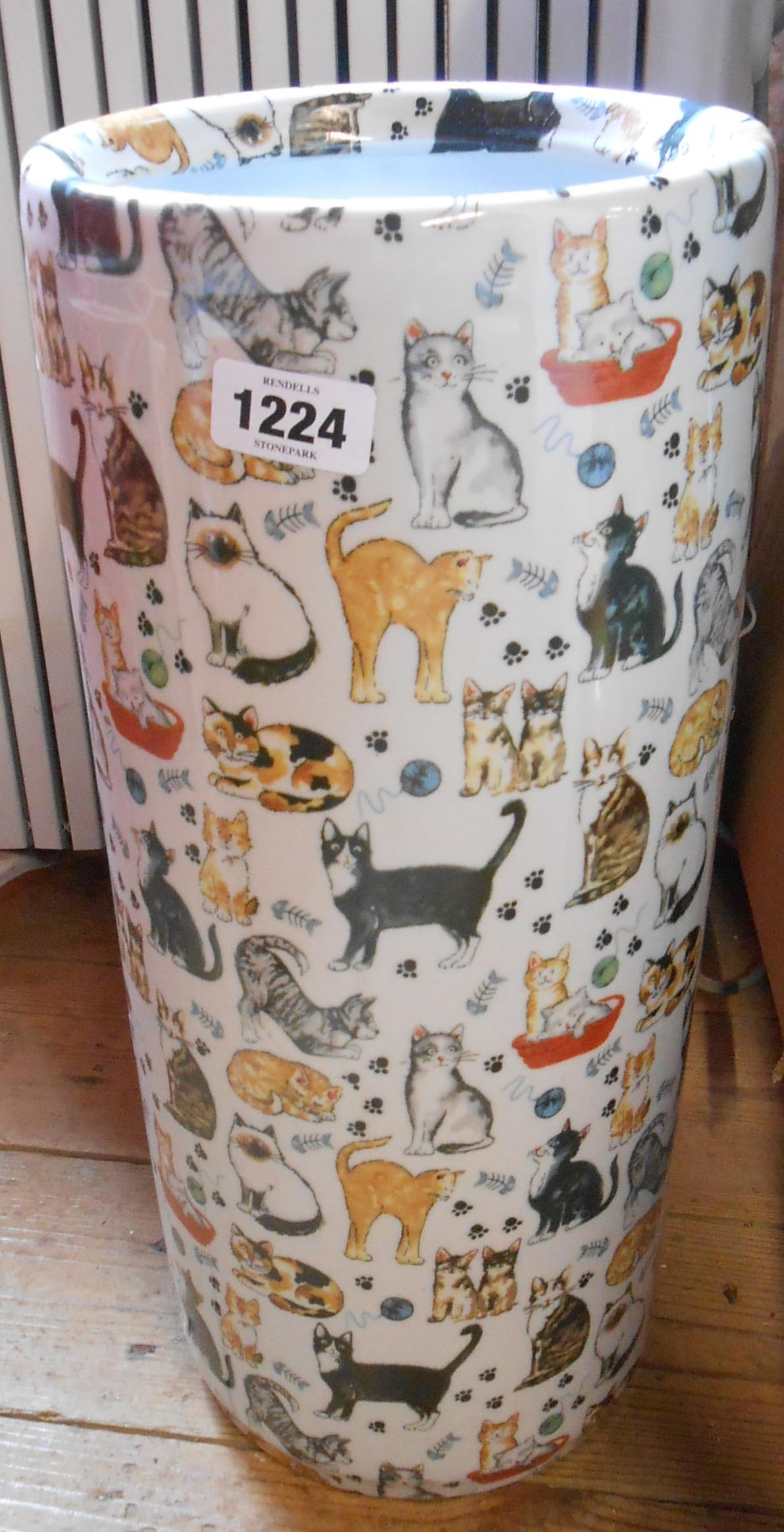 A china stick stand decorated with cats