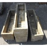 Three concrete trough form garden planters - sold with another example, cracked in two