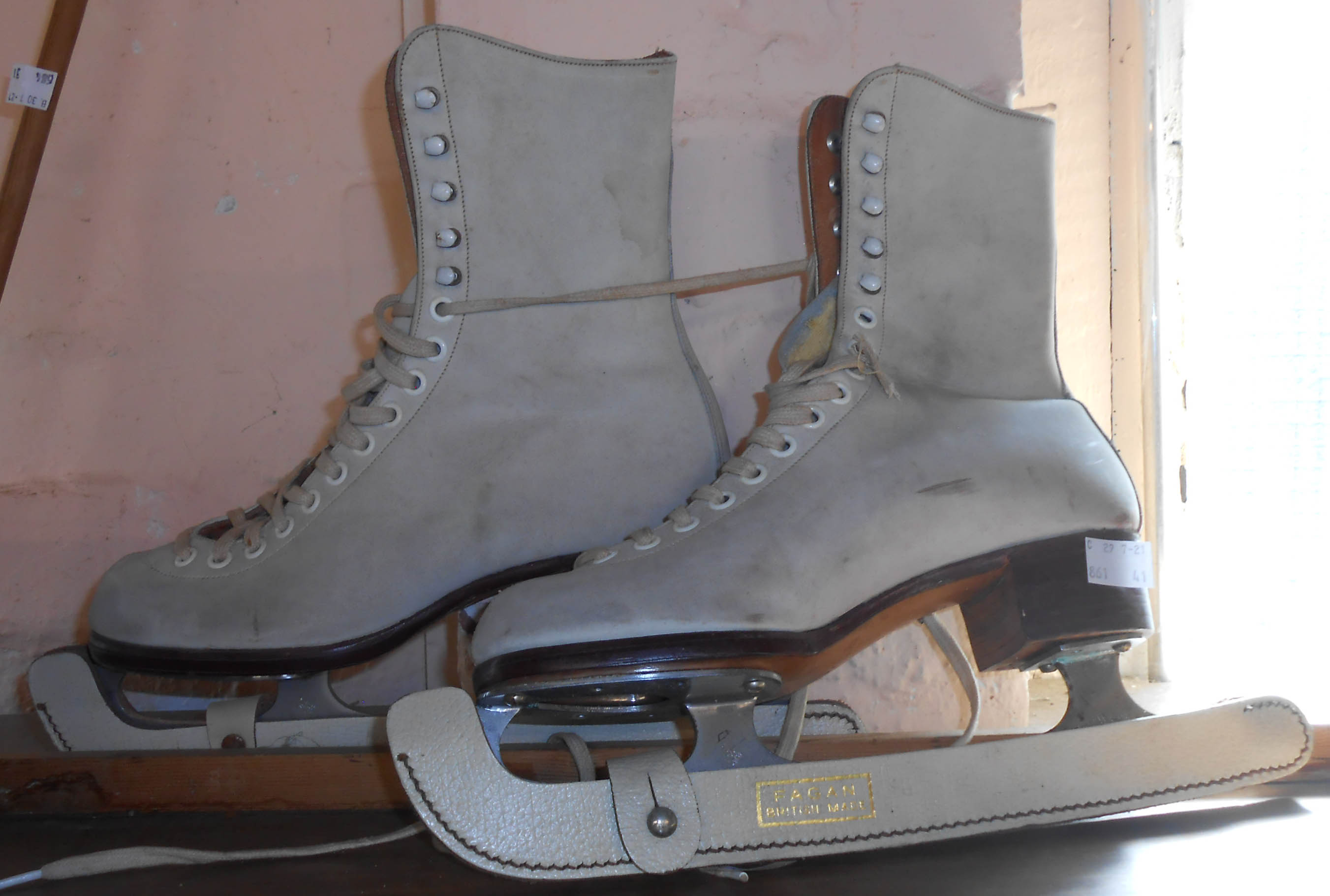 A pair of vintage Fagan leather ice skates with John Wilson steel blades and original blade covers
