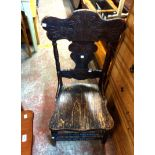 An antique stained wood standard chair with moulded gingerbread back, laminated seat and turned