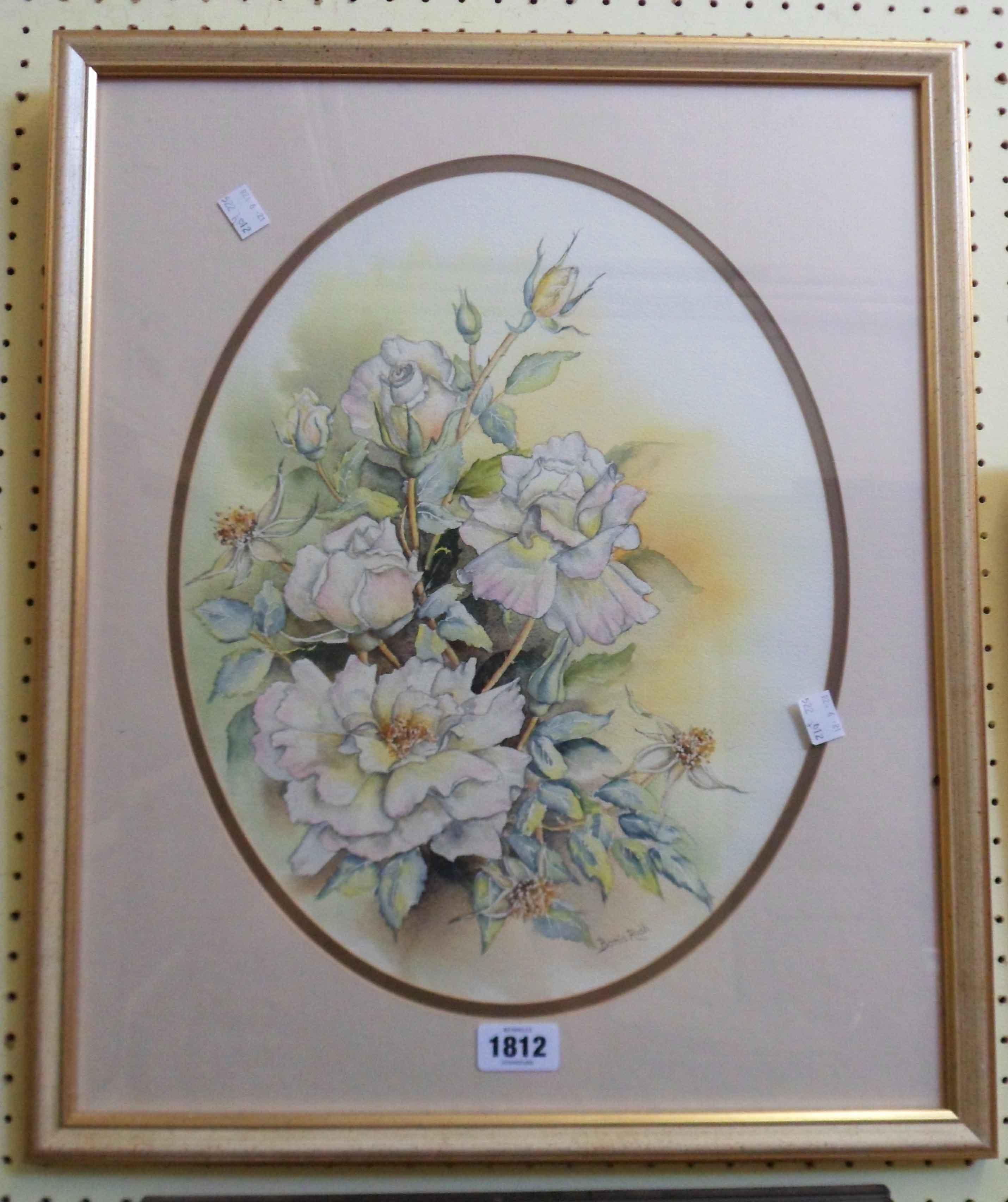Bonia Rush: a gilt framed still life study of roses - signed, in oval mount