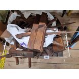 A crate containing assorted vintage woodworking and other tools including moulding planes,
