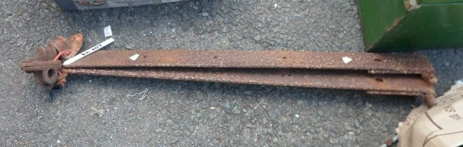 A pair of large strap hinges