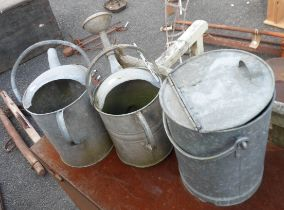 Two metal watering cans and metal bucket