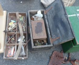 A wooden box containing assorted fixtures and fittings including hinges, bolts, plumbing fittings,