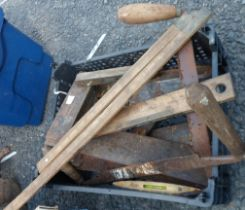 A crate containing assorted woodworking tools