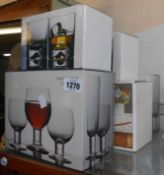 Five boxed sets of Dartington crystal glasses comprising tumblers, wine glasses, brandy balloons,