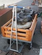 A large heavy duty metal garden trolley with added lift-out timber sides and removeable posts