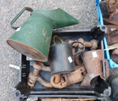 A crate containing assorted tools comprising a small vice, D shackles and oil cans