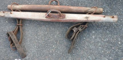Two old wood and iron yokes