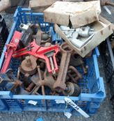 A crate of assorted tools including drill grinding jig, clamps, small vices, etc.